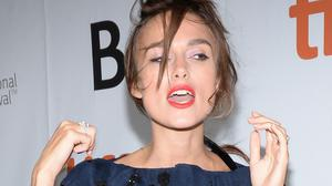 Keira Knightley's perfectly-coiffed hair got messed up by a gust of wind on the TIFF red carpet (Rex)