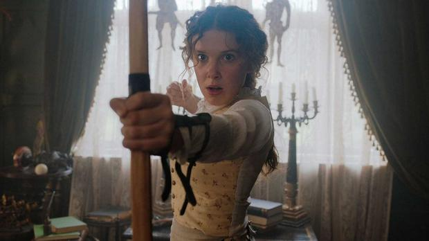 Taking aim: Millie Bobby Brown as Enola Holmes in the new Netflix film
