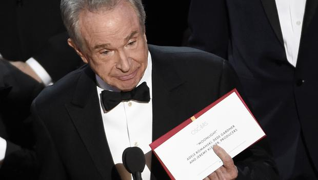 Warren Beatty holds up an envelope revealing Moonlight as winner of best picture at the Oscars (AP)