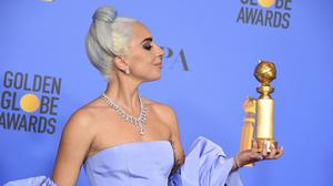 Lady Gaga paid tribute to her A Star Is Born co-star Bradley Cooper as she picked up a best song Golden Globe (Jordan Strauss/Invision/AP)