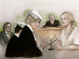 Court artist sketch of Amber Heard giving evidence at the High Court during a hearing in Johnny Depp's libel case (Elizabeth Cook/PA)