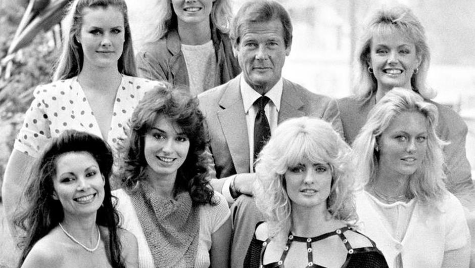 Roger Moore with seven of the actresses who appeared in Octopussy (PA)