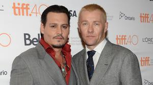 Johnny Depp with co-star Joel Edgerton at the premiere of Black Mass at the Toronto International Film Festival. (AP)