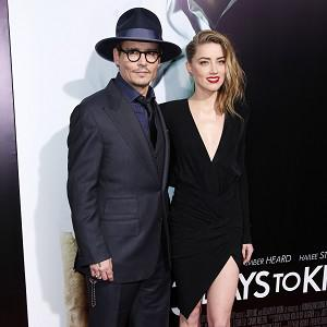 Johnny Depp and Amber Heard arrive at the premiere of 3 Days To Kill