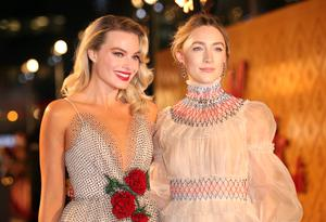 Margot Robbie (left) and Saoirse Ronan at the premiere for Mary Queen of Scots (Isabel Infantes/PA)