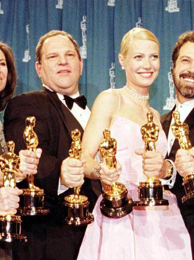 Harvey Weinstein and Gwyneth Paltrow with Oscars won for Shakespeare In Love in 1999 (PA)