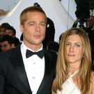 Celebrities got excited about Brad Pitt and Jennifer Aniston's reunion (Ian West/PA)