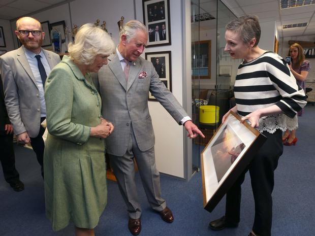 Top draw: Nora Twomey presenting Camilla, The Duchess of Cornwall and Prince Charles with an image from The Breadwinner in Kilkenny. Photo: Damien Eagers
