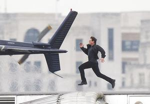 Tom Cruise runs along Blackfriars Bridge in London, during filming for a previous Mission: Impossible film (Victoria Jones/PA)