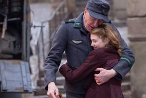 EVOCATIVE: Liesel, played by Sophie Nelisse and Geoffrey Rush as Hans Huberman in 'The Book Thief', a film which puts a different spin on the traditional war story