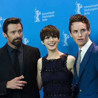 From left, actors Hugh Jackman, Anne Hathaway and Eddie Redmayne pose at the photo call of the film Les Miserables at the 63rd edition of the Berlinale, International Film Festival in Berlin, Germany, Saturday, Feb. 9, 2013. (AP Photo/Gero Breloer)