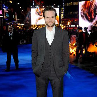 Rafe Spall said seeing his nudity on the big screen surrounded by his family was a little awkward