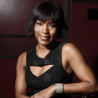 Angela Bassett stars with Morgan Freeman in Olympus Has Fallen