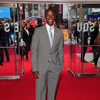 Don Cheadle confessed he doesn't like stripping off on camera