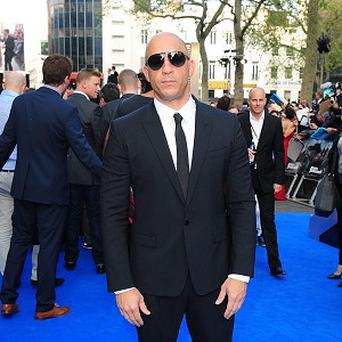 Vin Diesel arriving for the premiere of Fast and Furious 6