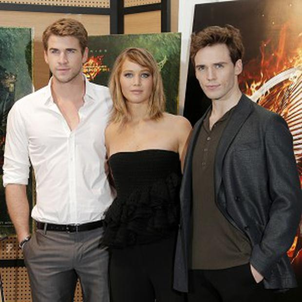Liam Hemsworth, Jennifer Lawrence and Sam Claflin posed for pictures in Cannes