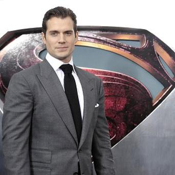 Henry Cavill is having to deal with the fame that comes with playing Superman