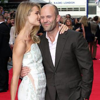 Jason Statham and Rosie Huntington-Whiteley arrive for the premiere of Hummingbird at the Odeon Leicester Square, central London