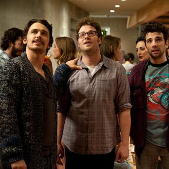 Seth Rogen, James Franco and Jay Baruchel all play versions of themselves in This Is The End