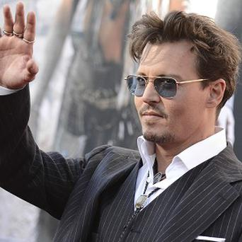 Johnny Depp arrives at the world premiere of The Lone Ranger at Disney California Adventure (AP)