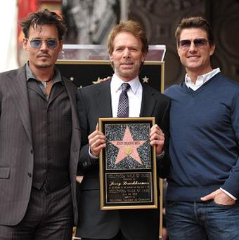 Johnny Depp and Tom Cruise paid tribute to Jerry Bruckheimer