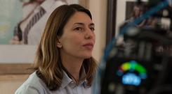 Sofia Coppola would rather be behind the camera on a movie set