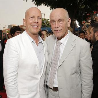 Bruce Willis and John Malkovich at the LA premiere of Red 2