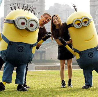 Steve Carell and Miranda Cosgrove voice characters in Despicable Me 2. The film and its minions have proved a box office hit