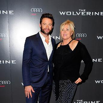 Hugh Jackman and Deborra-Lee Furness arriving for the UK Premiere of The Wolverine