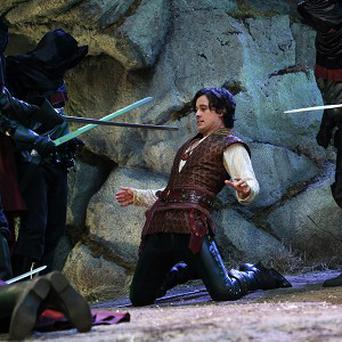Peter Gadiot, centre, as Cyrus in a scene from Once Upon A Time In Wonderland (AP/ABC, Jack Rowand)