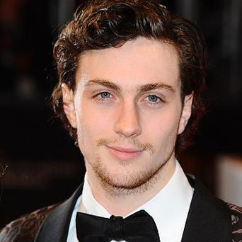 Aaron Taylor-Johnson joined director Gareth Edwards to offer a look at early footage from Godzilla