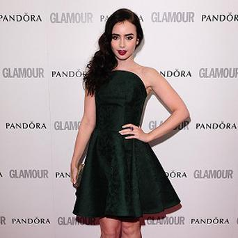 Lily Collins liked her sexy costumes in The Mortal Instruments: City Of Bones