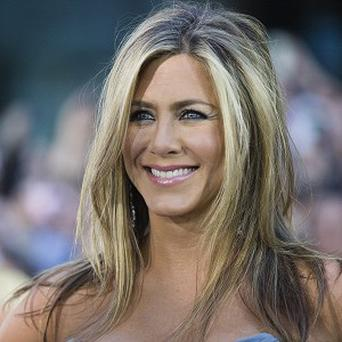 Jennifer Aniston has had to cut her hair off after she had a Brazilian blow dry that went wrong.