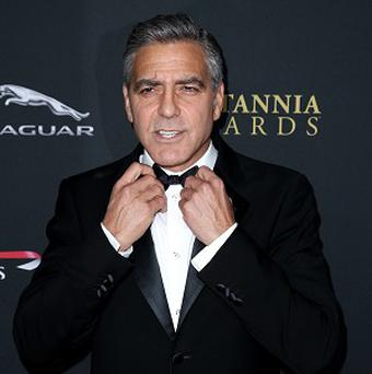 George Clooney plays pranks on his co-stars