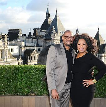 Forest Whittaker and Oprah Winfrey during a photocall for their new film The Butler, at the Corinthia Hotel in London
