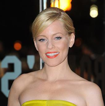 Elizabeth Banks wears a lot of crazy outfits in The Hunger Games