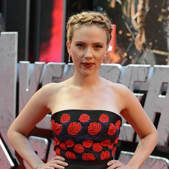 Scarlett Johansson has been told she can't be nominated for a Golden Globe for Her