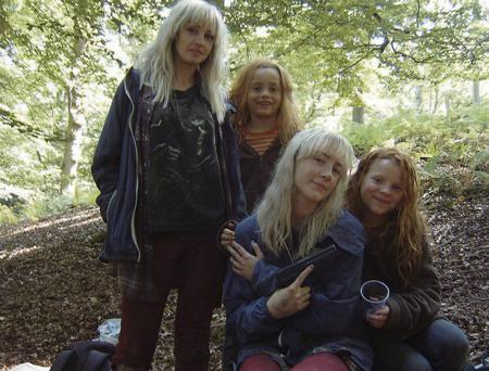 Body double Laura Harold on the set of the film 'How I Live Now'. Laura, pictured standing up, and Saoirse, pictured sitting down