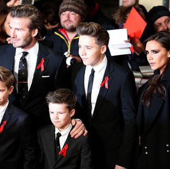 David and Victoria Beckham with their children Brooklyn, back row centre, Romeo. front left, and Cruz at the world premiere of The Class of 92 at London's Odeon Leicester Square