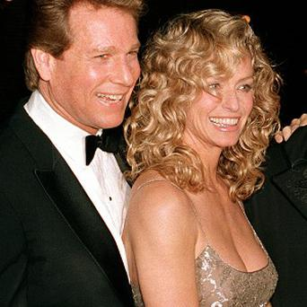 Ryan O'Neal, left, and Farrah Fawcett at the premiere of the film Chances Are in New York in 1989 (AP)