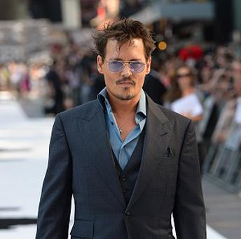 Johnny Depp wears some odd disguises when he is out and about