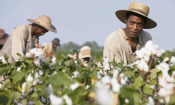 Grim reality: '12 Years a Slave' star Chiwetel Ejiofor; and below is Tarantino's 'Django Unchained'; inset left is 'Gone with the Wind