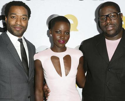 RHYTHM SECTION: Director Steve McQueen (right) with Chiwetel Ejiofor and Lupita Nyong'o, two of McQueen's 'band' of talented actors with whom he enjoys working. most recently on '12 Years a Slave'. Photo: Frederick M Brown/Getty