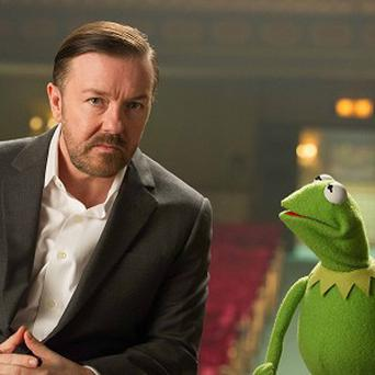 Ricky Gervais stars in Muppets Most Wanted opposite Kermit the Frog