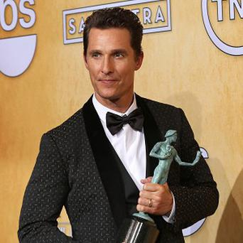Matthew McConaughey with his Screen Actors Guild award (AP)