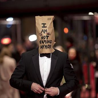 Curious visitors have been queueing for a glimpse of Shia LaBeouf wearing his paper bag
