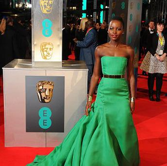 Lupita Nyong'o wore a strapless emerald green Dior ballgown to the Baftas