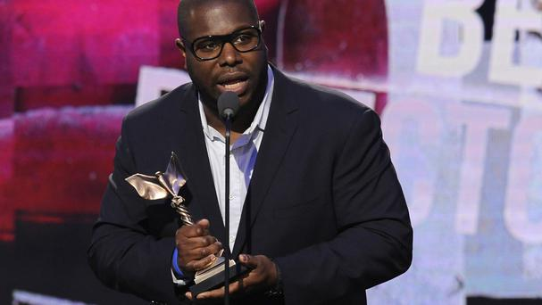 Steve McQueen accepts the award for best director for 12 Years A Slave at the 2014 Film Independent Spirit Awards in Santa Monica (Chris Pizzello/Invision/AP)