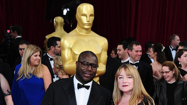 Steve McQueen and Bianca Stigter arriving at the 86th Academy Awards held at the Dolby Theatre in Hollywood, Los Angeles, CA, USA, March 2, 2014.