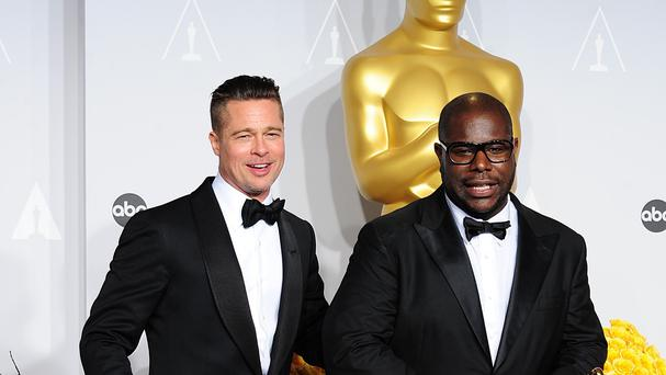 Producer Brad Pitt and and director Steve McQueen with their Oscars for 12 Years A Slave